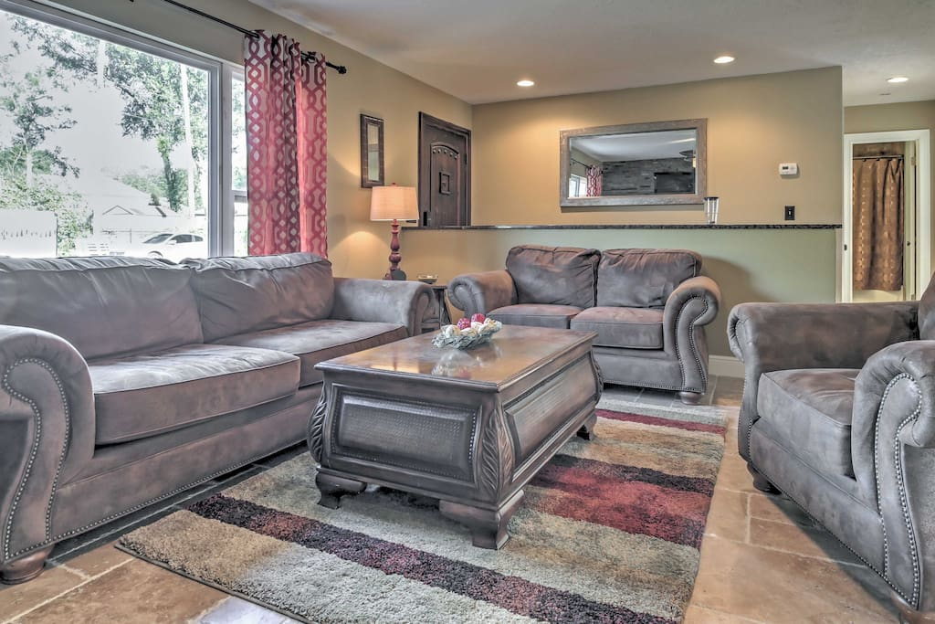The plush couches in the living room invite you to kick back and relax.