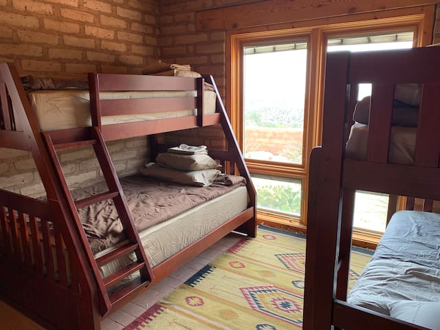 Additional guestroom with 2 sets of bunk beds (twin-over-full & twin-over-twin). Has a magnificent south-facing view of the Davis Mountains.