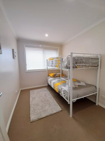 The third bedroom has a set of bunk beds.