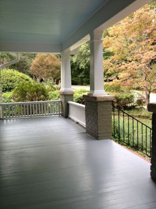 Your view of the front porch and yard as you sit on the porch swing.