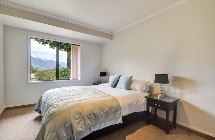 Master Bedroom with Queen Bed, Bedroom 1, with amazing lake and mountain views.