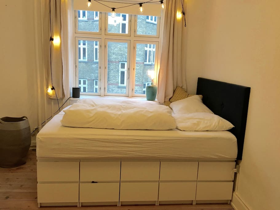 Bedroom with high bed
