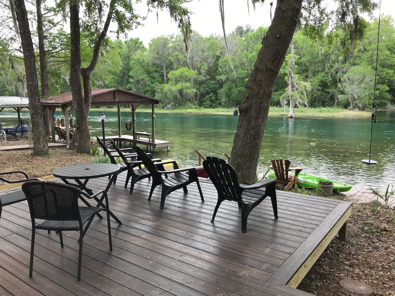 Large deck is great for outdoor dining or enjoying a glass of wine, soaking up the river.