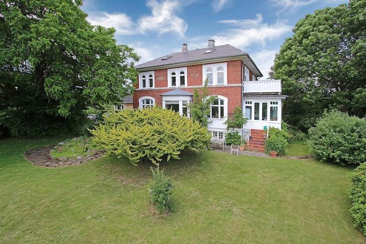 170 SQM apartment in Villa with own garden