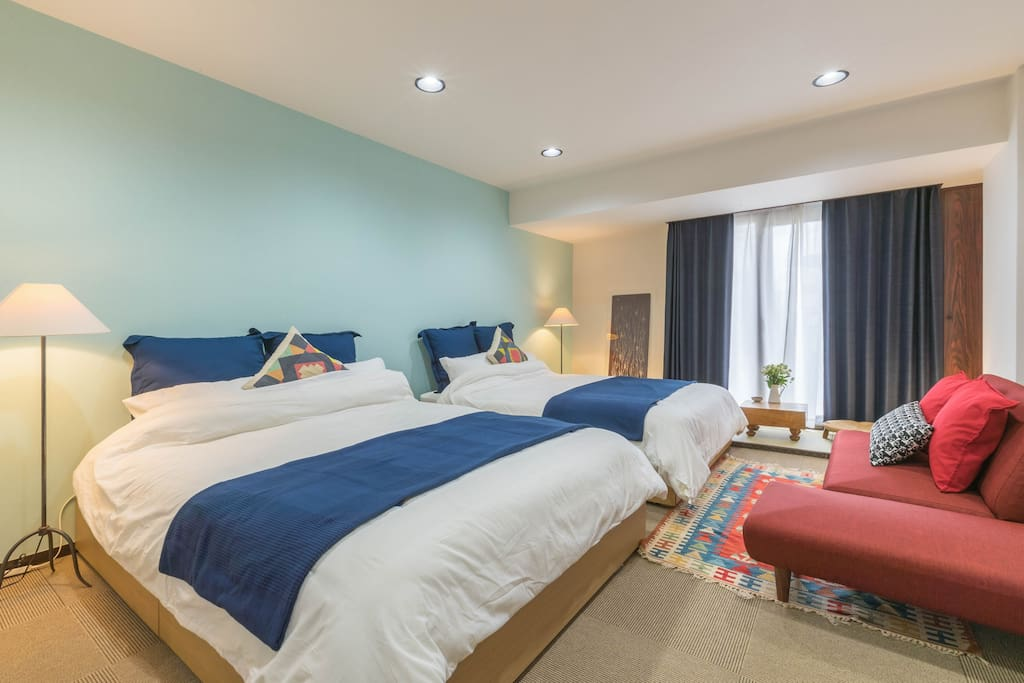 Light room with two double beds.