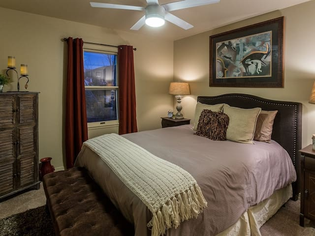 Upstairs guest bedroom with comfy Queen bed and down bedding