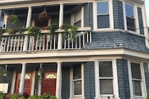 Front of house in spring- historic Federal Hill triple-decker