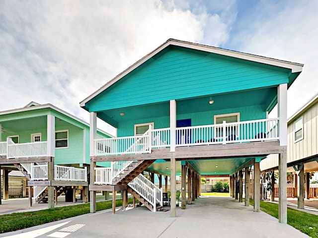 Embrace the sea breeze on the deck at this beautiful raised home.