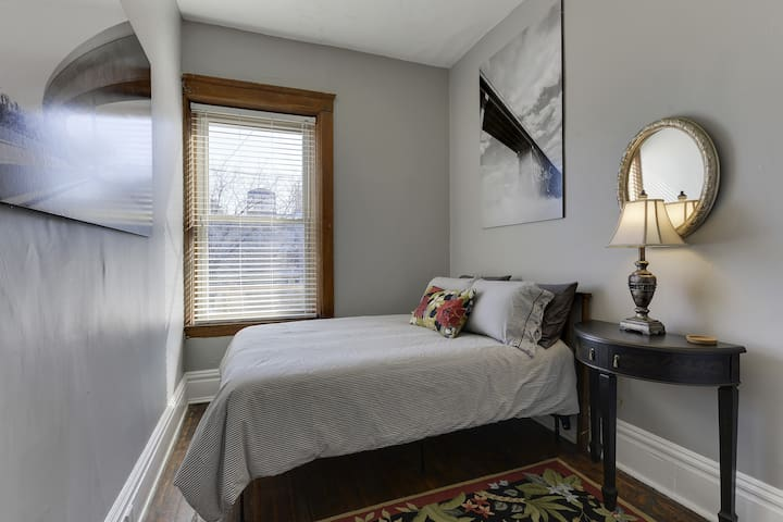 This is the smaller bedroom with full-size memory foam mattress, wool rug and a closet.