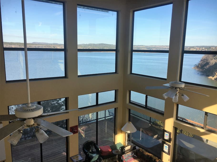 Large floor to ceiling windows show off full lake view