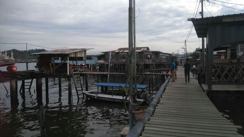 Still houses connected by wooden bridges to every corner of water village.