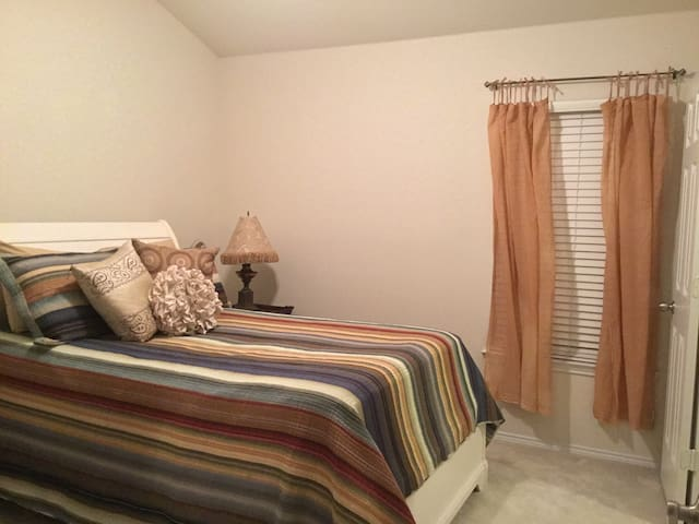 Bedroom with desk, nightstand, and dresser
