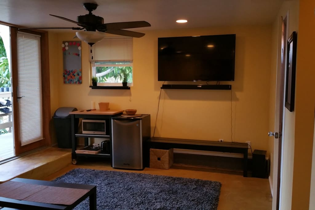 """60"""" television with sound bar system, and DVD."""