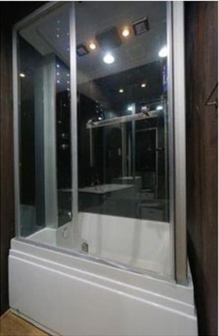 Modern shower booth with bath