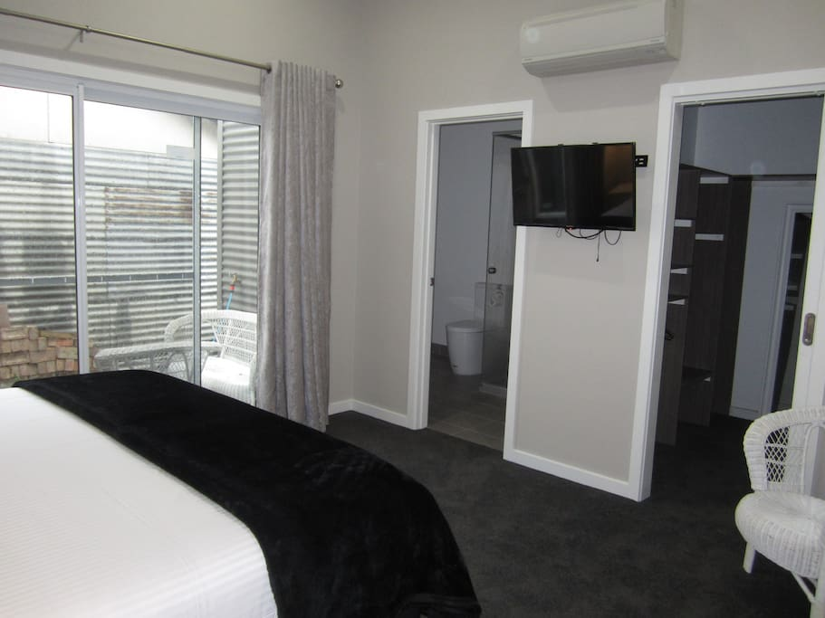 Master bedroom has air-con, TV with DVD player, ensuite and Walk in Robe