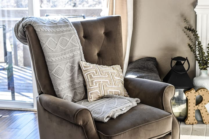 Reclining chair perfect for catching up with friends or relaxing and reading a book.