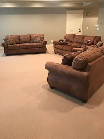 Three couches (two have queen sized pull out beds)