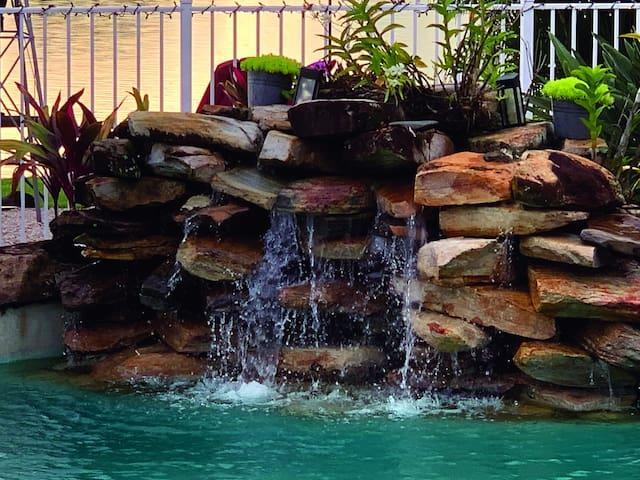 Enjoy the waterfall in the resort style pool area