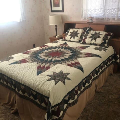 Guest Bedroom with Queen Bed from entryway