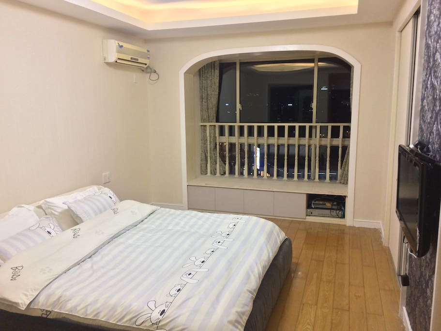 Master bedroom,king size bed, including a small washroom