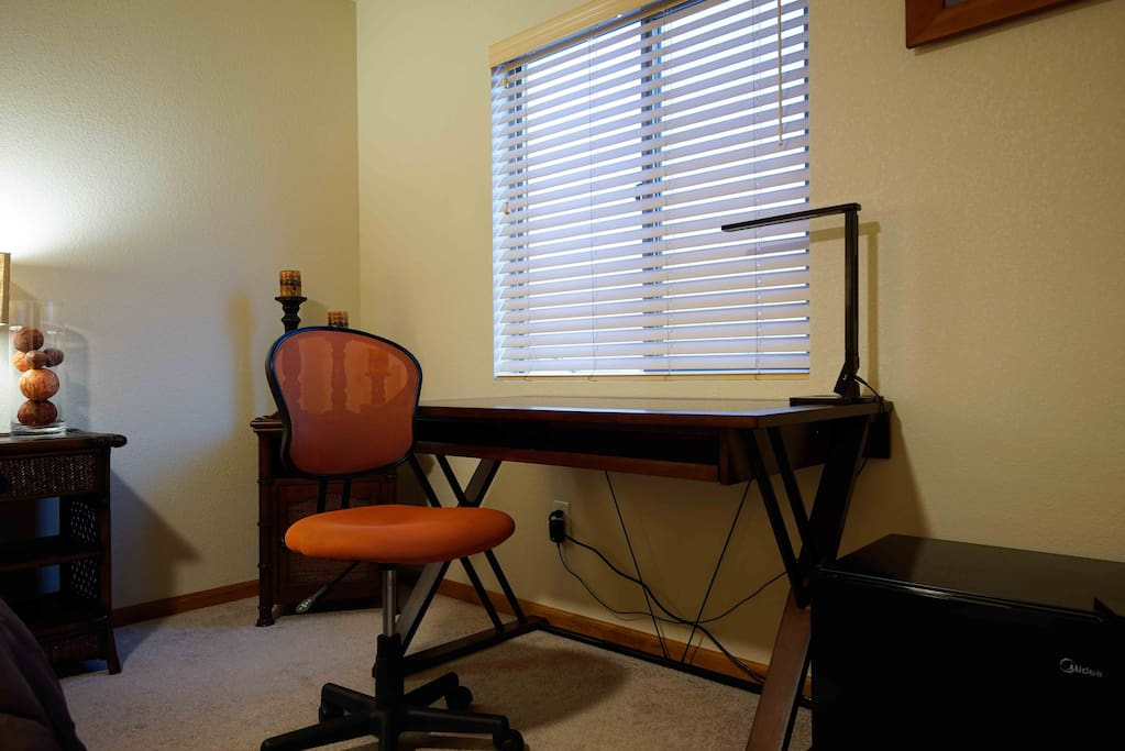 Wide desk and modern chair