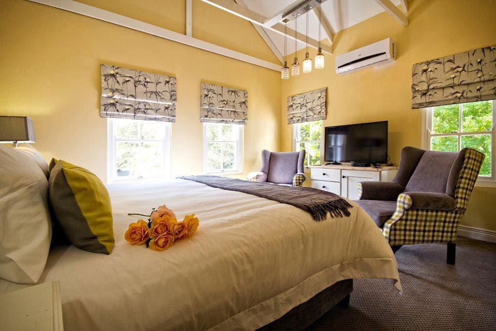 King Size Bed with Television and Sitting Area,  Coffee Facilities,  Air Conditioning (Heating & Cooling)