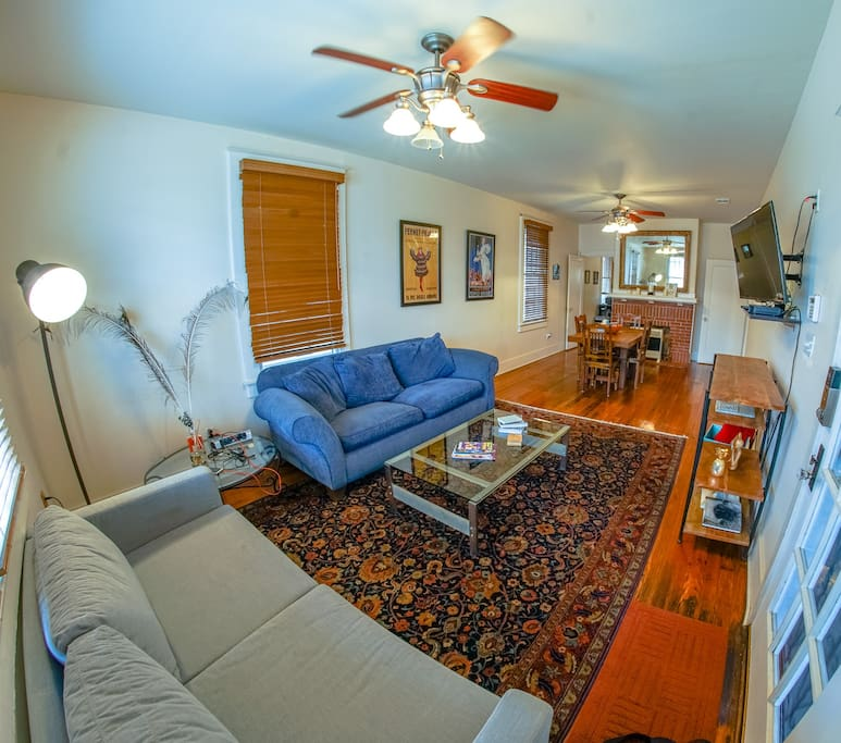 The spacious living space has a small dining area with a great dining room table.