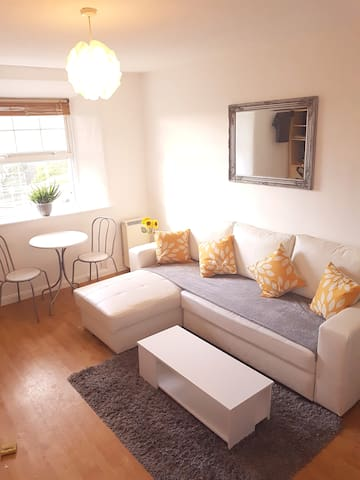"""The front room offers a relaxing, spacious and bright space complete with breakfast dining table and 42"""" Samsung HD TV."""