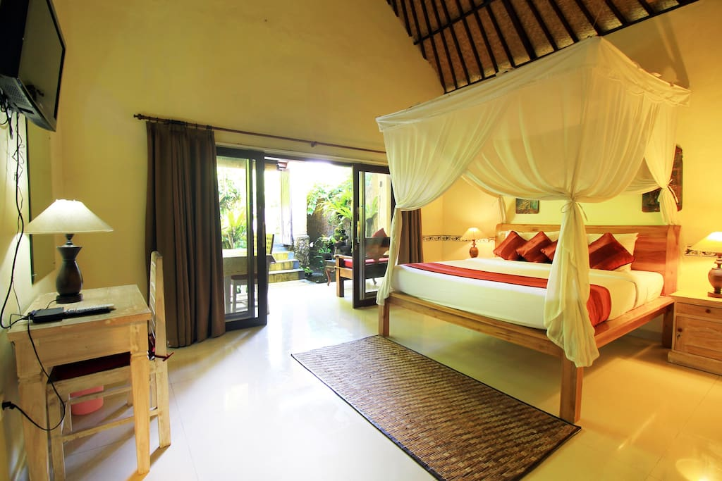 The King Size Bed With Comfortable Mattress and Mosquito net.