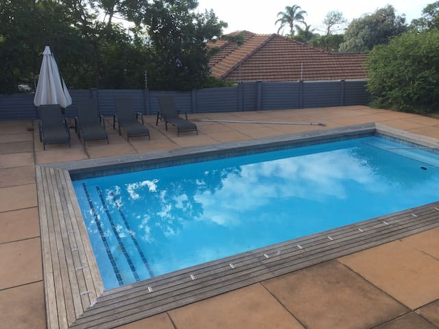 big pool with X4 loungers