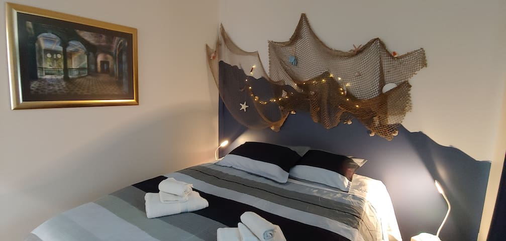 The Ocean Feeling bedroom with illumination if you want it. Write a  bottle post if you wish and stick it in there... The night lamps are dimmable and offer also different lights for your moods- pink, blue, green...