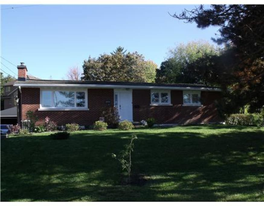 Front of house- double landscaped lot in great neighborhood.