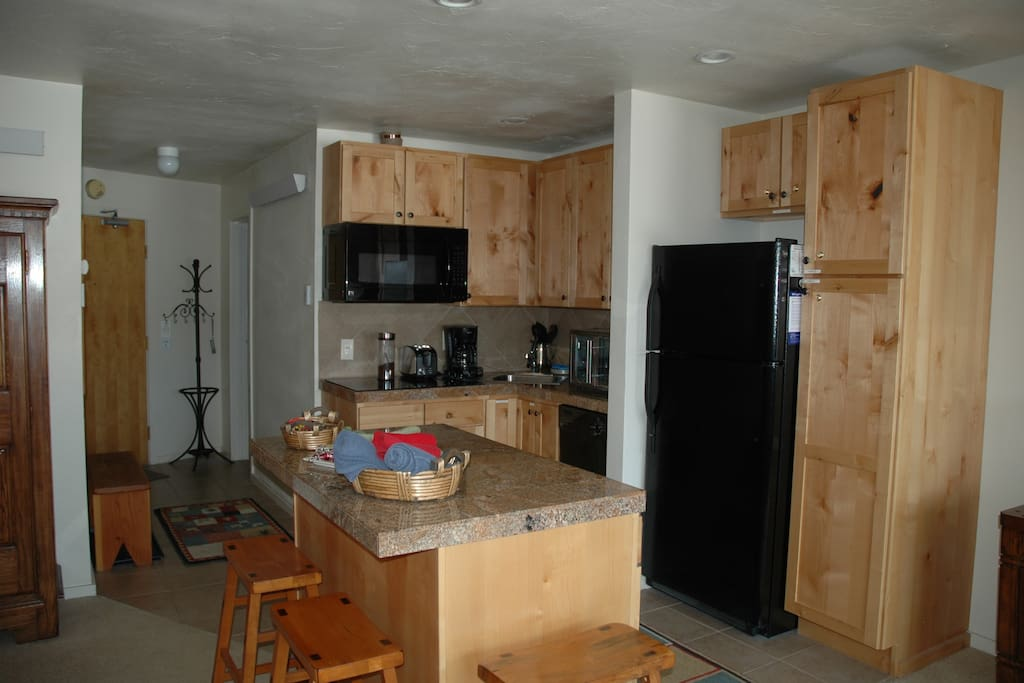Well appointed new kitchen with full size refrigerator, oven, microwave and stovetop.