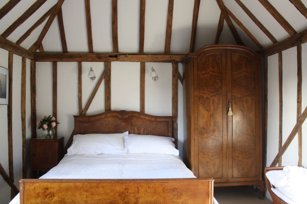 The bedroom with vaulted ceiling