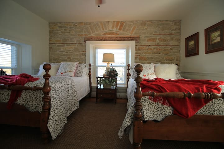 Upstairs bedroom with two double beds