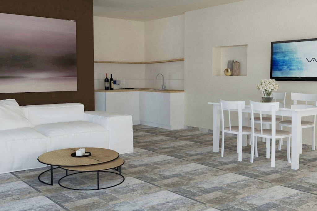 The bright and spacious living area has a top luxury furniture. Equipped with a comfortable sofa, flat screen TV with cable television, table with chairs, Wi Fi connection, mini bar and air conditioning.