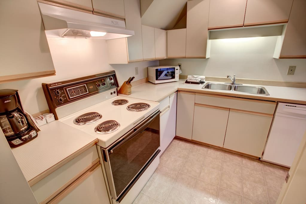 The fully equipped kitchen is ready to use with plenty of counter space.