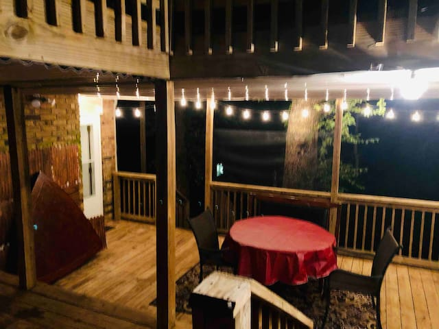 Cozy covered deck porch with lighting that's accessible to all guests.