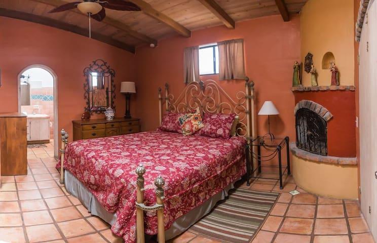 Master Bedroom with King Bed, Fireplace & en suite bathroom.