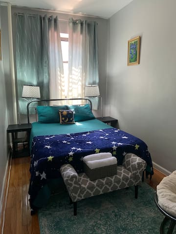 Cozy room with turquoise accent in historic Harlem