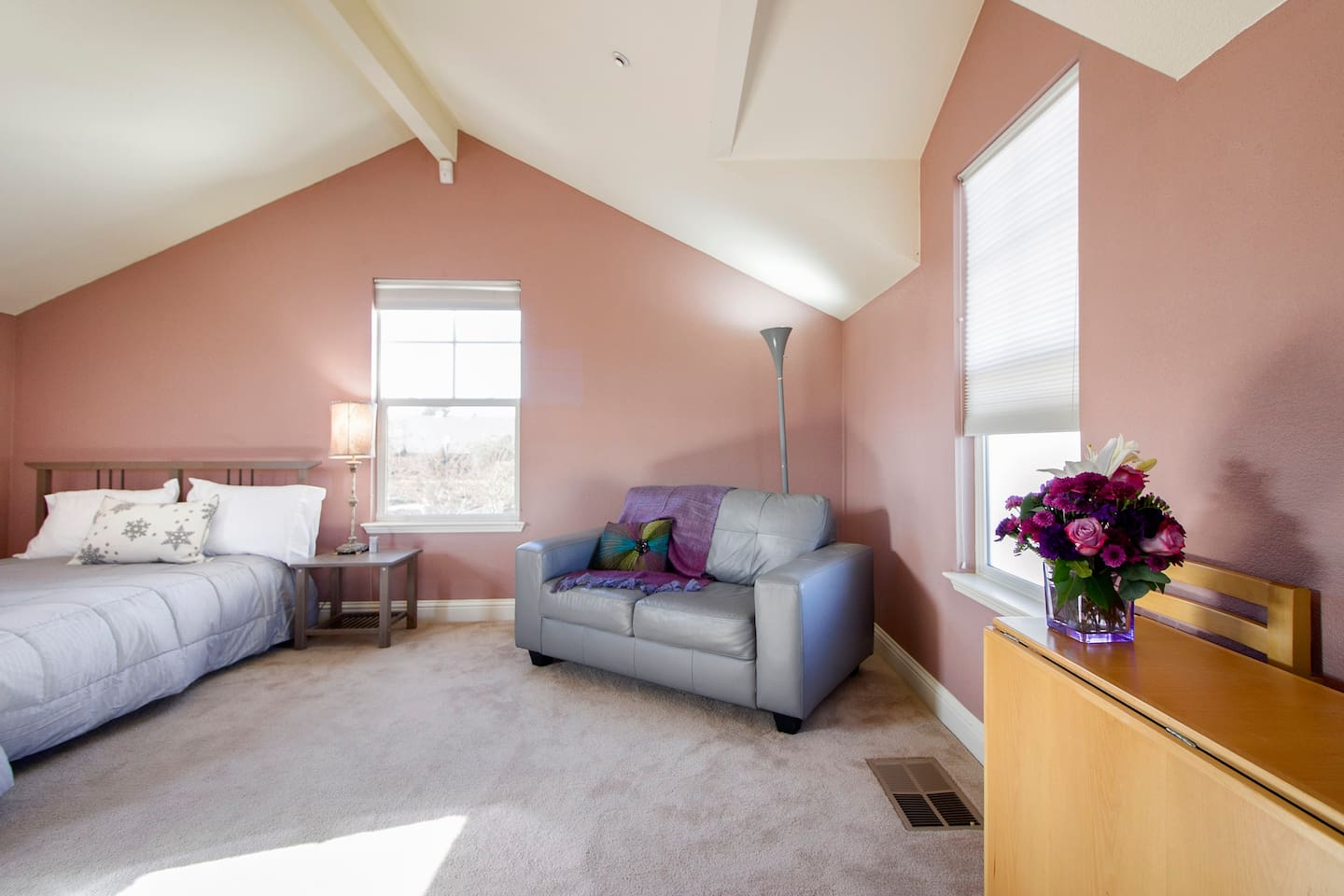 Beautiful spacious studio featuring bed, love seat, and pull out dinner table