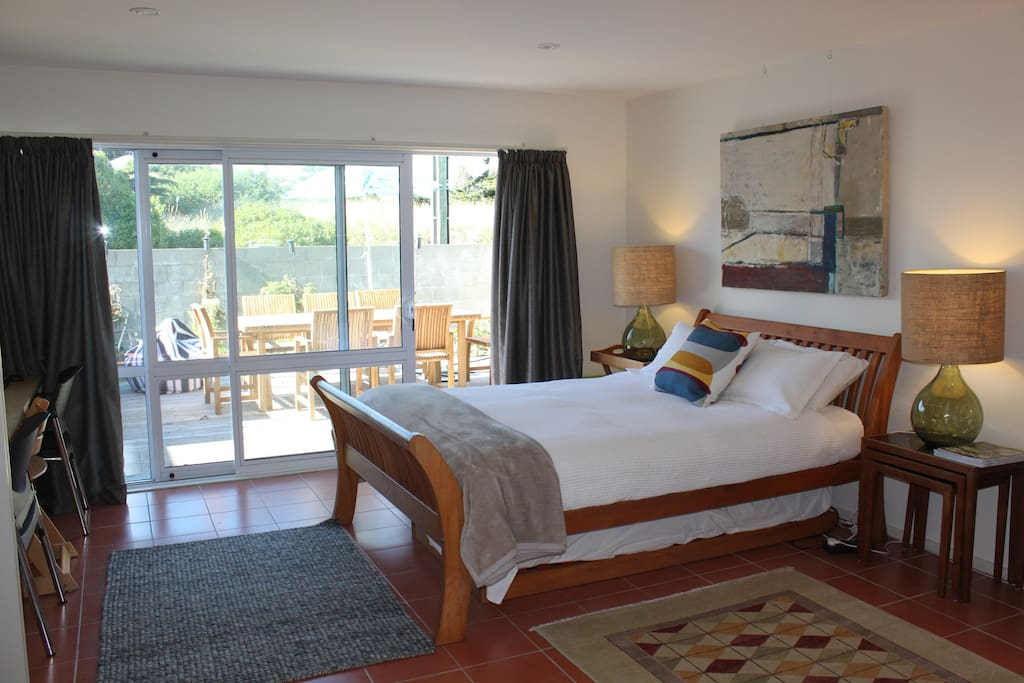 Light, airy room with private deck, own entrance. Includes continental breakfast.