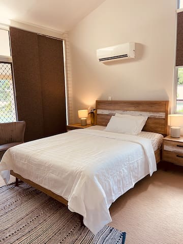 Bedroom 1 (en suite with own bathroom and large walk-in wardrobe). South facing with single unit air conditioner. Own private patio if required.