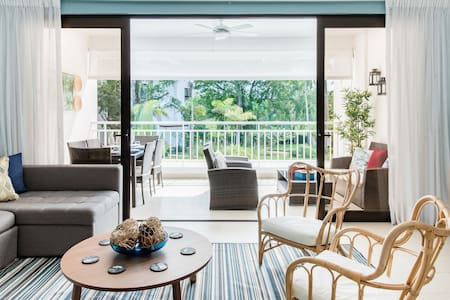 Chic Poolside Condo, Seconds from Tropical Sands