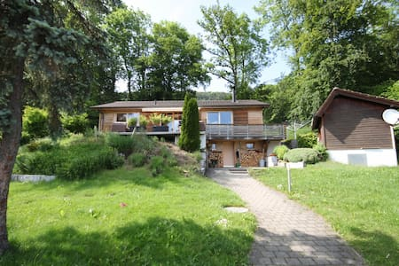 Wooden house with large garden near Basel