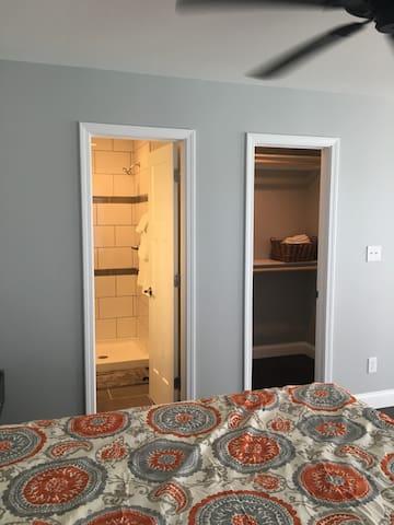 Bathroom with shower; walkin closet