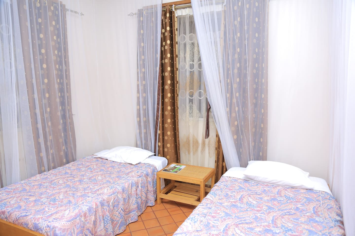 Our twin room, well organised , specious with a private birth room. Amazing for you and that friend that u would want to have a long talk with all night .