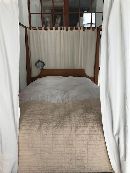 Feather bed with curtains.