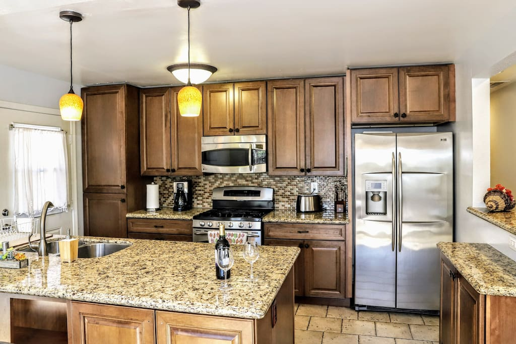 Kitchen is fully equipped with top of the line appliances and cooking utensils.