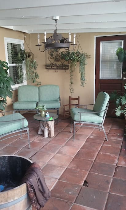 Access to Outdoor  patio surrounded by gardens